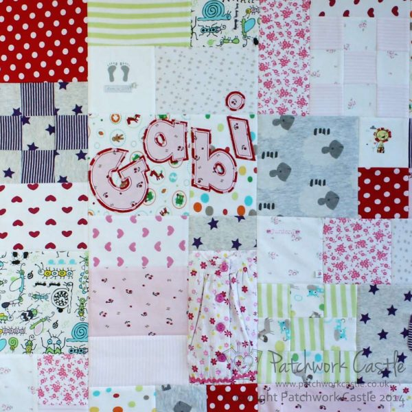 Larger section of baby clothes keepsake patchwork memory quilt