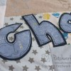 Detail of name applique on a boy's baby clothes keepsake memory quilt