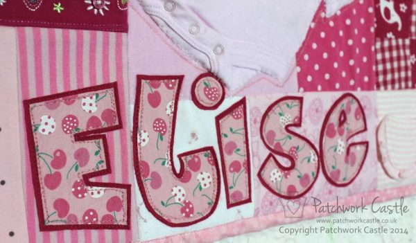 Girl's name applique on a personalised keepsake baby clothes memory quilt