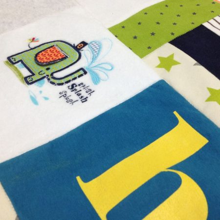 Beautiful patchwork made from baby clothes.
