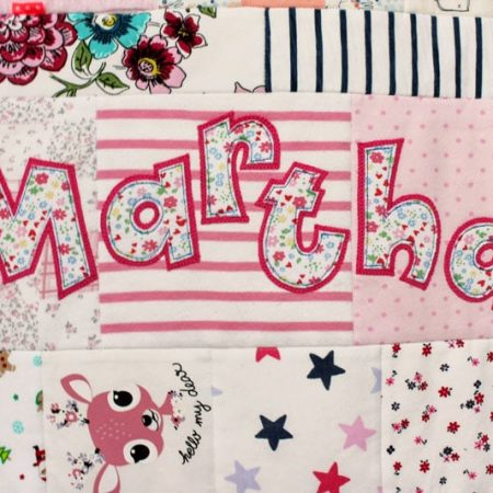 Name applique on a memory quilt
